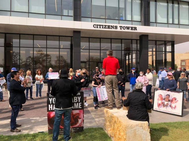 Members of West Texas for LIfe rally in front of Citizens Tower.