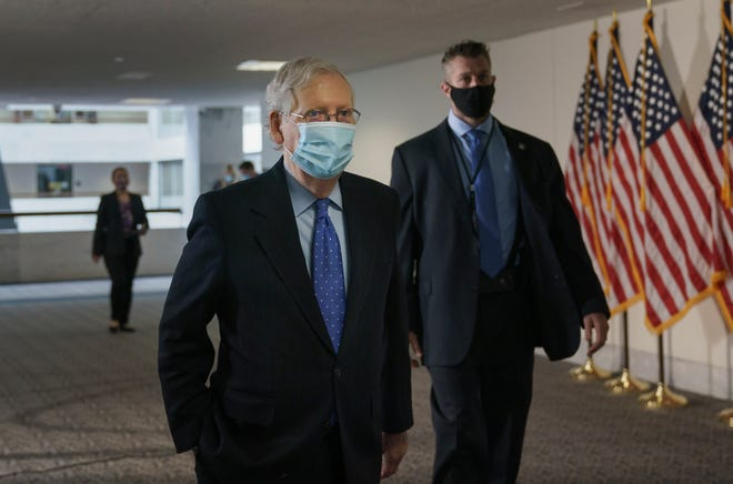 Senate Majority Leader Mitch McConnell, R-Ky., arrives for a closed-door meeting with Senate Republicans, on Capitol Hill in Washington on Friday. McConnell said there's nothing the public needs to know about his health after photos showed what appears to be bruising on his hands and around his mouth.