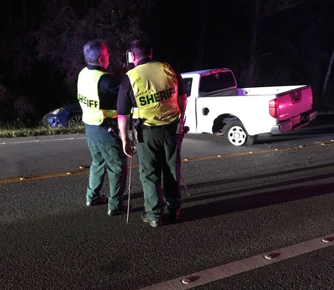 Polk County Sheriff's Office deputies work the scene of a fatal four-vehicle accident on State Road 60 Friday night.