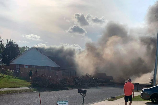 A U.S. Navy training plane crashed in an Alabama residential neighborhood near the Gulf Coast on Friday near Foley, Ala. (Greg Crippen via AP)