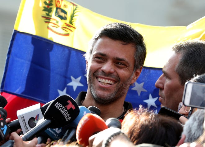 Venezuelan opposition leader Leopoldo Lopez smiles during a May 2019 news conference at the gate of the Spanish ambassador's residence in Caracas, Venezuela. Lopez left the residence where he had been a guest since April 30, 2019, and is leaving Venezuela people close to the opposition leader said on Saturday.