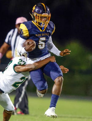 Winter Haven running back Xavier Marlow tries to fly past George Jenkins defender Deshawn Wilson earlier this year. Winter Haven, at 3-3, travels to play undefeated Bartow on Friday.