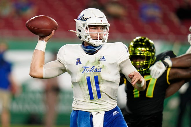 Tulsa quarterback Zach Smith throws a pass against South Florida during the first half Friday in Tampa.