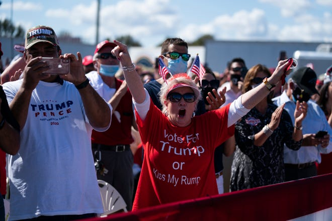 Supporters of President Donald Trump cheer as he arrives for a campaign rally at Robeson County Fairgrounds on Saturday in Lumberton, N.C.