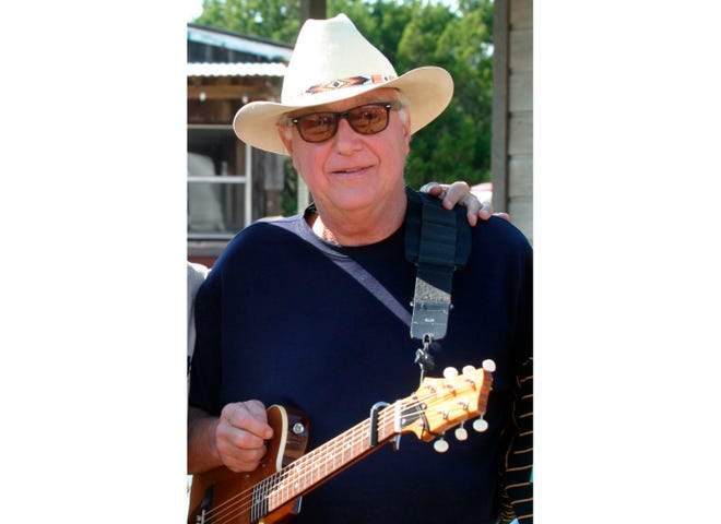 """Country singer Jerry Jeff Walker attends an October 2005 campaign fundraiser at Willie Nelson's ranch outside Austin, Texas. The Texas country singer and songwriter who wrote the pop song """"Mr. Bojangles,"""" has died at age 78. Family spokesman John T. Davis said Walker died Friday after battling throat cancer and other health issues for several years."""