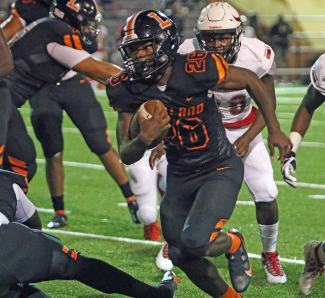Lakeland running back Don'ares Johnson runs for a gain against Bloomingdale on Friday night at Bryant Stadium.