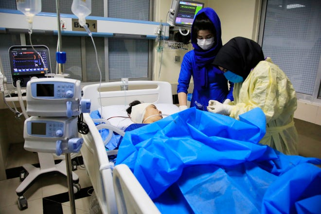 An Afghan receives treatment at hospital after suicide attack in Kabul, Afghanistan, on Saturday. The death toll from the suicide attack Saturday in Afghanistan's capital has risen that includes schoolchildren, the interior ministry said.
