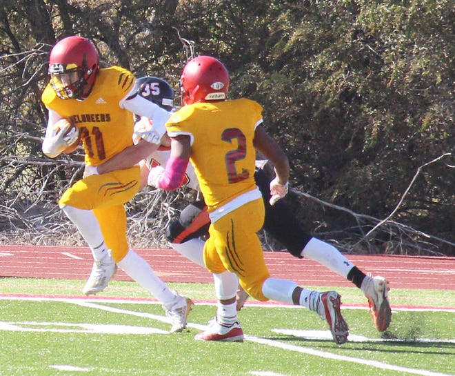 Rocky Ford High School's Jasha Smith (11) runs with the ball after intercepting Bennett quarterback Mikey Babi in Saturday's game at Melon Field. The Meloneers lost the game 51-0.