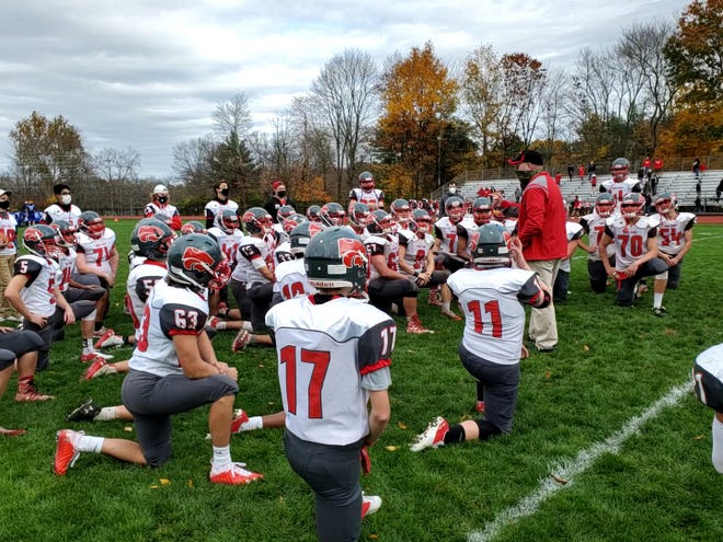 High Point head football coach Jim Delaney talks with his team following its 27-0 win over Kittatinny on Oct. 24 at Kittatinny High School.