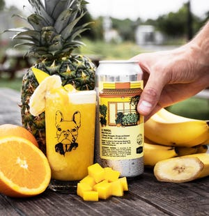 Limited-run El Tropical craft beer, inspired by a smoothie at Celis Produce, is a collaboration between family-owned Celis, which has a location in Royal Poinciana Plaza, and Civil Society Brewing. COURTESY CIVIL SOCIETY BREWING