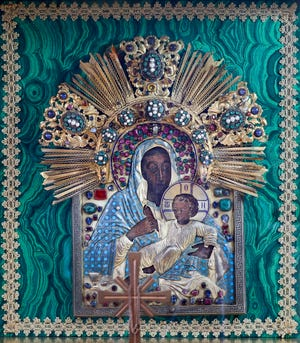 In 2001 Edward and Adele Kahn, owners of House of Kahn Estate Jewelers, donated a jewel-encrusted painting of the Virgin Mary and the Christ Child created in the 16th century to St. Mary Catholic Church in Pahokee, the poorest in the Diocese of Palm Beach.  A 2008 appraisal places the value at $1.3 million, and today its value exceeds $2 million.  (DAMON HIGGINS / THE PALM BEACH DAILY NEWS)
