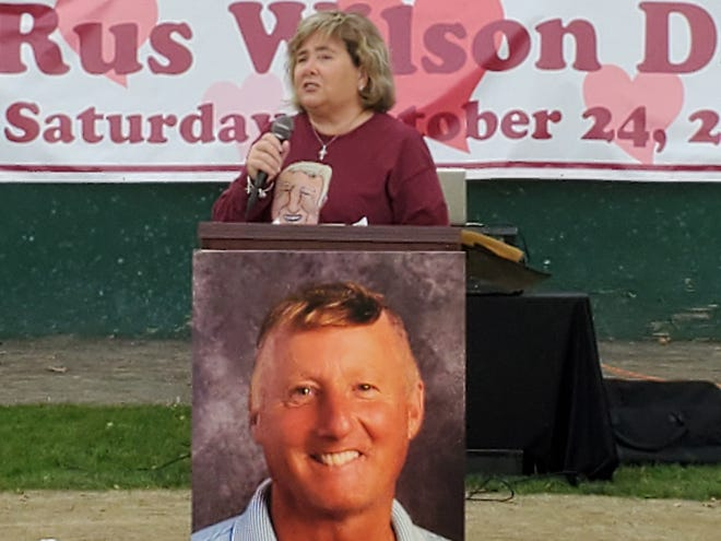 Chris Wilson, wife of the late Rus Wilson, spoke to people gathered for the celebration of his life at Leary Field on Saturday, Oct. 24, 2020. [Karen Dandurant/Seacoastonline]
