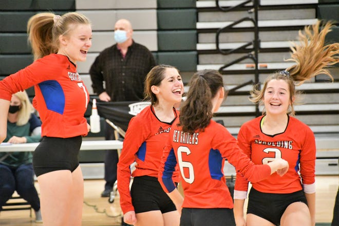 Spaulding beat rival Dover in Division I volleyball action on Friday in five sets. Celebrating a point are, from left, Maddie Heon, April Beatty, Ambra Breakfield, and Grace Beaulieu.