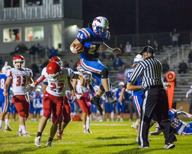 Winnacunnet running back Matt Alkire leaps into the end zone for a touchdown during the fourth quarter of Friday night's 21-6 win over Spaulding in Hampton.