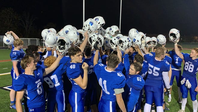 Pleasant Valley High School's football team celebrates a 43-0 victory over East Stroudsburg North on Friday, Oct. 23, 2020. The Bears earned their first win since Oct. 5, 2018.