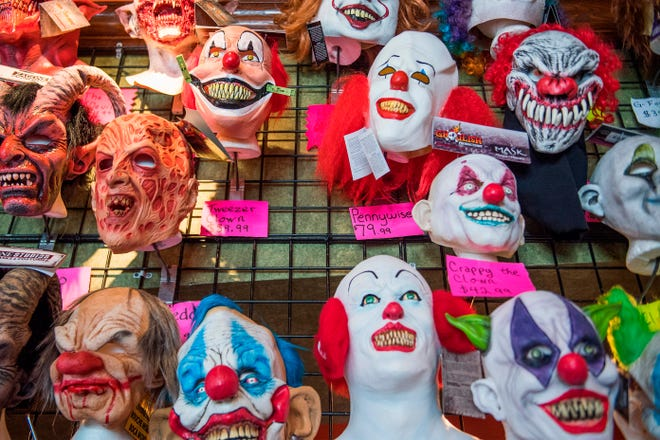 Halloween masks adorn the wall of a costume shop in Annapolis, Maryland, on October 16, 2018. (Jim Watson/AFP via Getty Images/TNS)