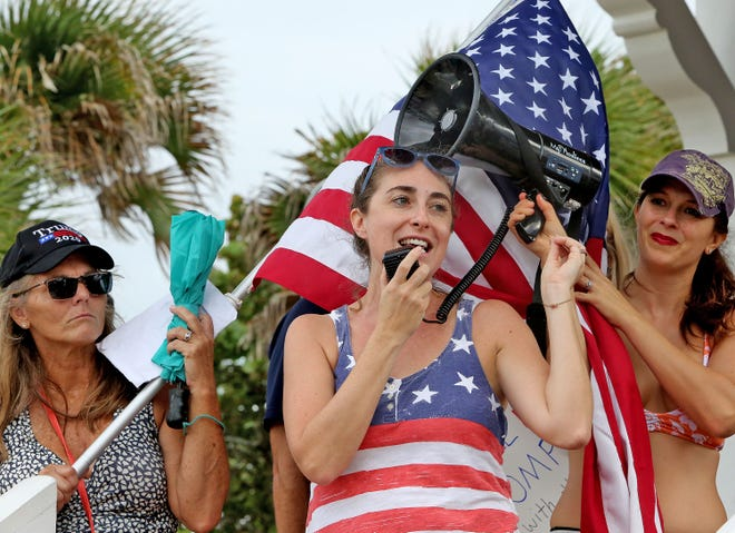 Community Activist Josie Machovec, of Boca Raton, speaks Oct. 24 in Delray Beach to a crowd protesting mask mandates. The group marched along Atlantic Avenue before setting several masks on fire in a tin-foil pan.