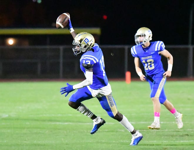 Cardinal Newman cornerback Keith Golden Jr. celebrates the first of his two interceptions during Friday night's win over Miami-Belen Jesuit. The senior was recognized as defensive player of the night for his two forced turnovers.