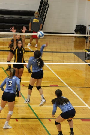 Skyline High School volleyball players put it to their South Barber opponents during a busy week of competitive play.