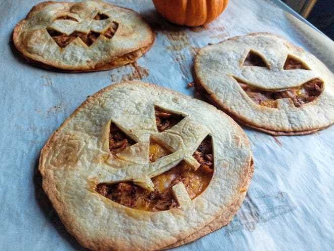 Stuffed with chicken and cheese, jack-o'-lantern quesadillas make a quick and easy dinner on Halloween. (Pittsburgh Post-Gazette/TNS)
