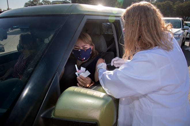 Angeles Ortiz gets a free flu shot from LVN Jeri Denby Oct. 24 at the San Joaquin County Clinics in French Camp.