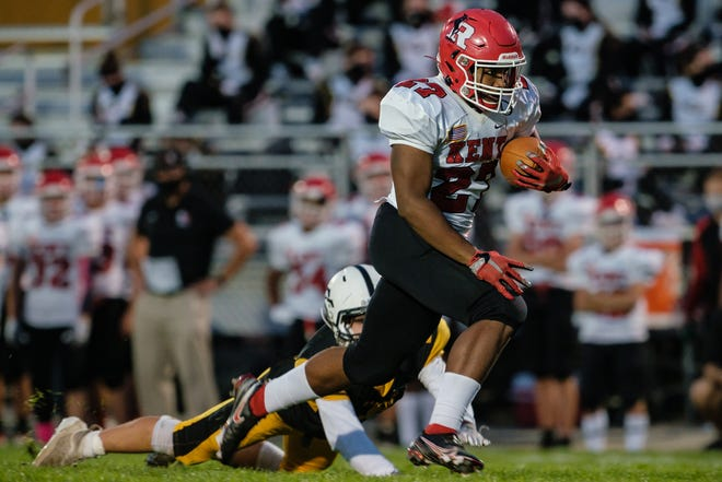 Quinten Upshaw makes his way down field evading multiple tackles to score Roosevelt's second touchdown of the game against Cuyahoga Falls Friday, October 23, 2020 in Cuyahoga Falls.