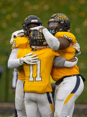 Streetsboro and Dover finished the game postponed from the night before due to weather. Rockets win 54-21. Keisean Johnson-Wilson, Ritchell McCallister and Michael Hall Jr. celebrate their playoff win.
