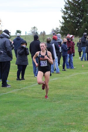 Walsh's Alexa Leppelmeier, shown here at the Great Midwest Athletic Conference Cross Country Championships in Tiffin, broke her own school record in the 3,000-meter run at the NCAA Division II Indoor Track and Field Championships.