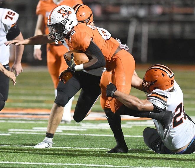 Massillon's Wiltrell Hartson tries to pull away from Hoover's in the first half of Hoover at Massillon football  Friday, October 23, 2020.