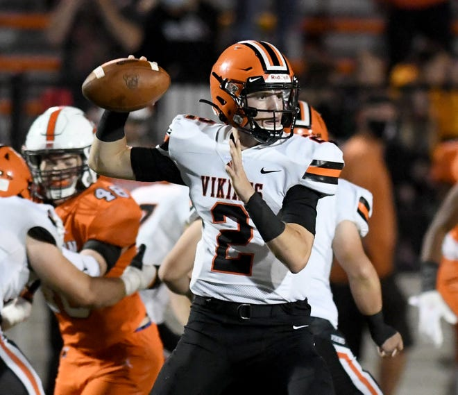 Hoover's Connor Ashby looks for a receiver in the first half of Hoover at Massillon football  Friday, October 23, 2020.