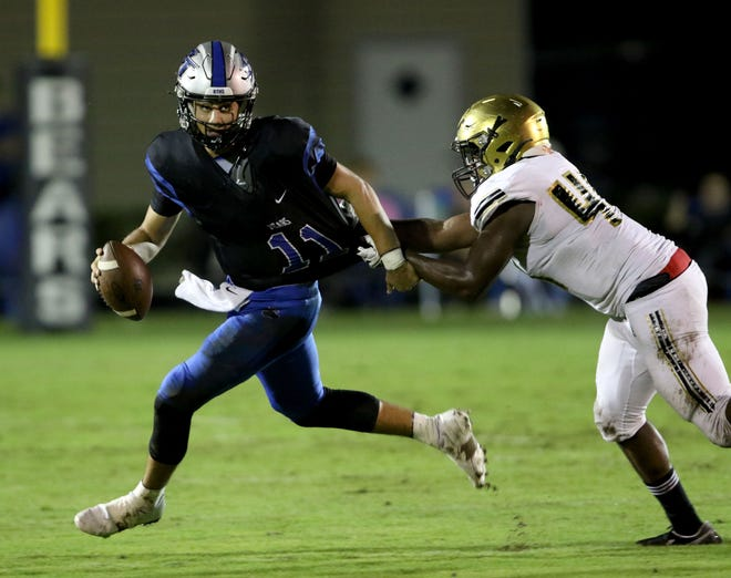 Bartram Trail quarterback Santino Marucci runs from an Oakleaf defender in the third quarter Oct. 23, 2020. Bartram Trail faces Oakleaf just four weeks after a 30-27 win.
