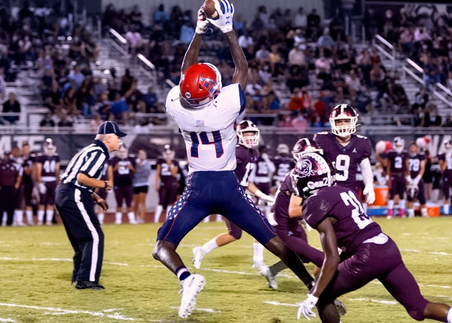 Manatee High receiver Jayden Corbett leaps to haul in a long pass for a touchdown in second quarter action Friday night against Braden River High on Friday night 10/23/2020.