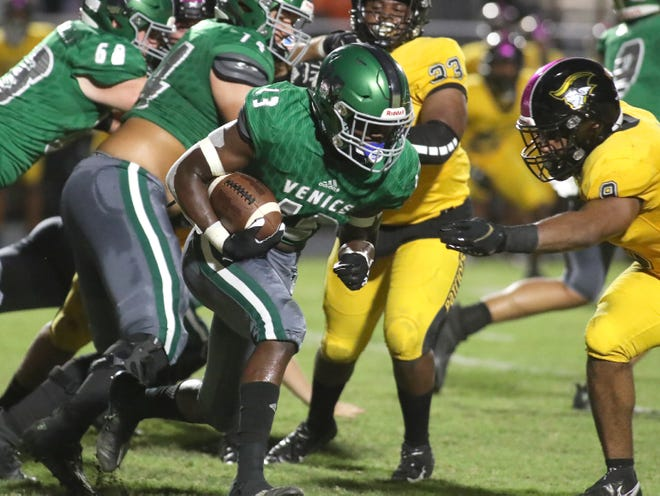 Venice High running back Da'Marion Escort runs with the ball past American Heritage Plantation at Powell-Davis Stadium in Venice on Friday. The Indians lost 41-26.