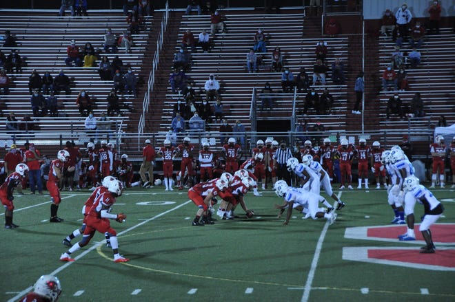 Smyrna runs a play against Dover Oct. 23 in the season opener for both football teams. Only two guests per Smyrna athlete were allowed as spectators, with no visiting spectators permitted.
