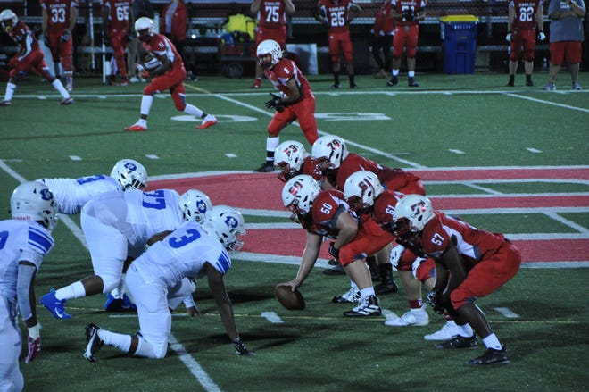 Smyrna High School's offense lines up to run a play against Dover Oct. 23 at Charles V. Williams Stadium in Smyrna.