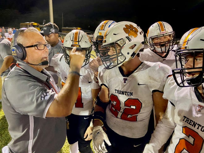 Trenton head coach Bill Wiles calls a play during a second-half timeout Friday night at Williston. The Tigers beat the Red Devils 40-38.