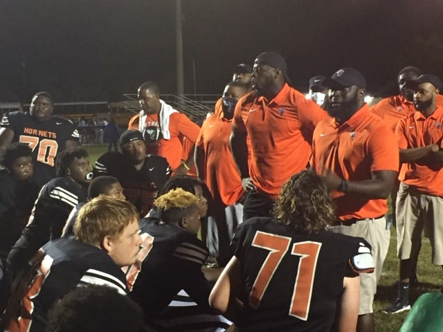 The Hawthorne coaching staff talks to the Hornets on Friday.