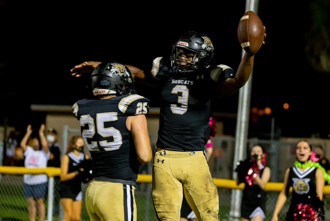 Buchholz running back Quandarius Smith (3) celebrates his rushing touchdown with teammate Jason Martin (25) against Fleming Island at the P.K. Yonge Football Fields in Gainesville on Friday.