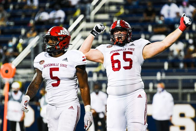 Jacksonville State running back Josh Samuel (5) and lineman Michael Shaddix (65) celebrate during the Gamecocks' victory at FIU.