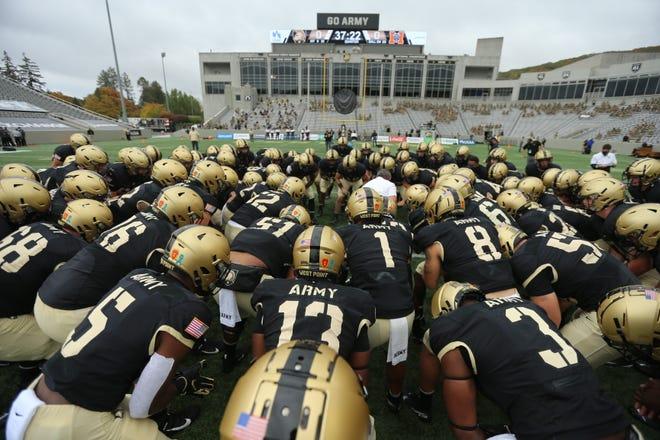 Army huddles before Saturday's game against Mercer at Michie Stadium.