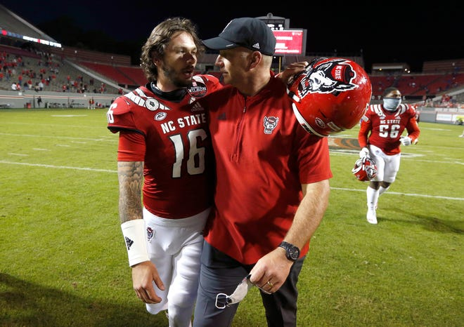 NC State quarterback Bailey Hockman and coach Dave Doeren congratulate each other after a victory over Duke earlier this season.
