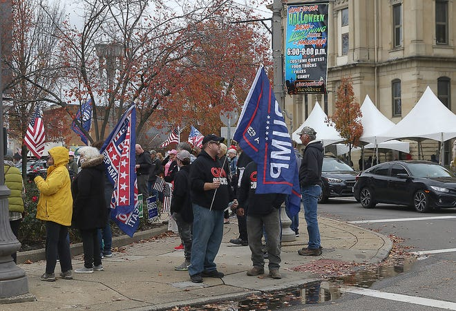 Trump supporters rallied in the square in New Philadelphia Saturday across the street from the courthouse.