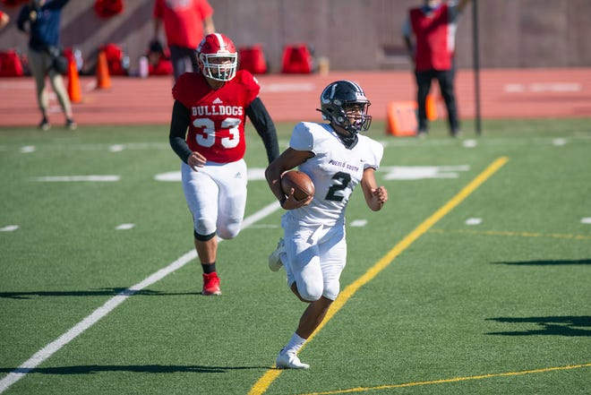 South High School's George Longoria gains yardage on a run play against Centennial on Saturday October 24, 2020 at Dutch Clark Stadium.