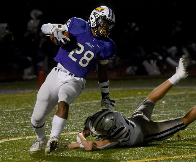DeSales' Quintell Quinn avoids a tackle attempt by Granville's Ashton Housteau during the teams' Division III, Region 11 playoff game. The game began Oct. 23 and finished the next day because of bad weather. The Stallions won 56-35.