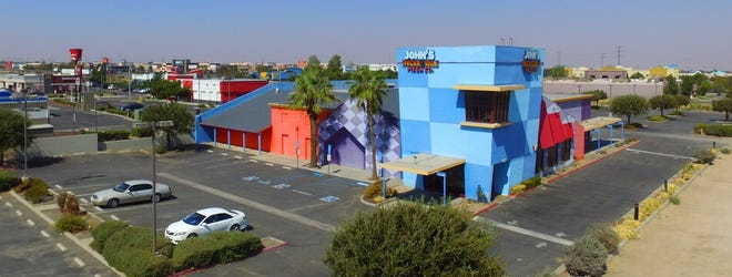 The shuttered John's Incredible Pizza Company on Bear Valley Road in Victorville has been listed for sale with a price tag of more than $2.9 million.