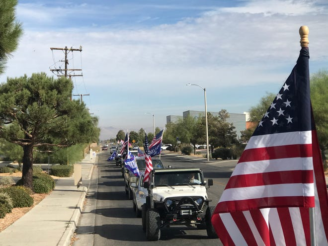 A vehicle parade of President Donald Trump supporters makes its way through Hesperia, near the Civic Plaza 12 movie theater, on Saturday, Oct. 24, 2020.