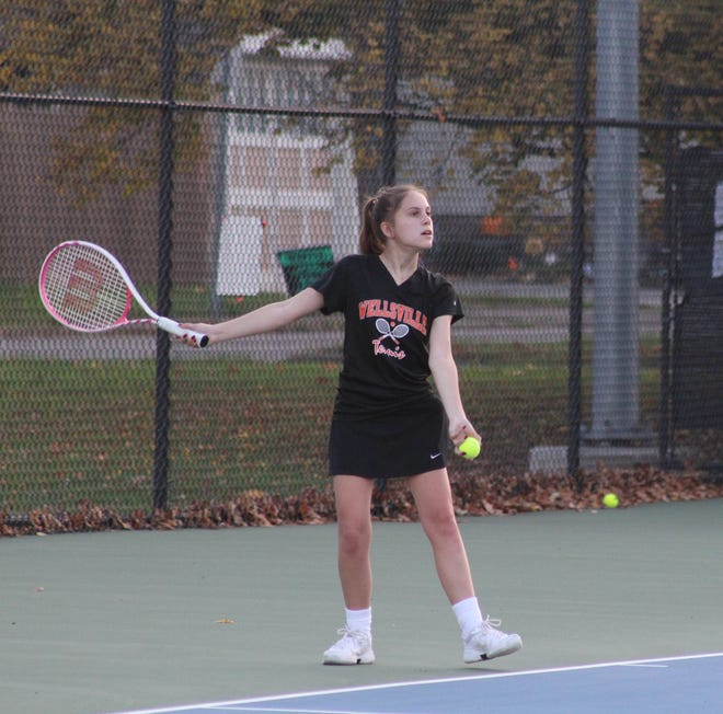 Wellsville's Alexa Hill readies for a serve at third singles.