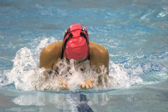 Wellsville's Hayden Waldon competes in the 100 breaststroke in Thursday night's win over Haverling.