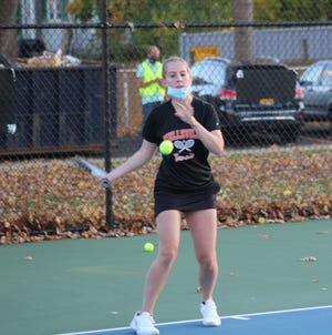 Wellsville senior Cassie Kling hits a return shot at first singles Friday night against Wayland-Cohocton.