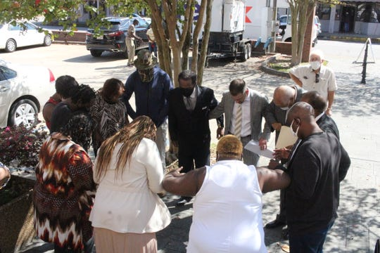Vincent Simmons' family members, supporters and lawyers pray after a motion for post-conviction relief was presented to the 12th Circuit District Court on Tuesday in Marksville. Lawyer Justin Bond said new evidence shows that Simmons, turning 100 in Angola, did not commit two rapes for which he was convicted in 1977.